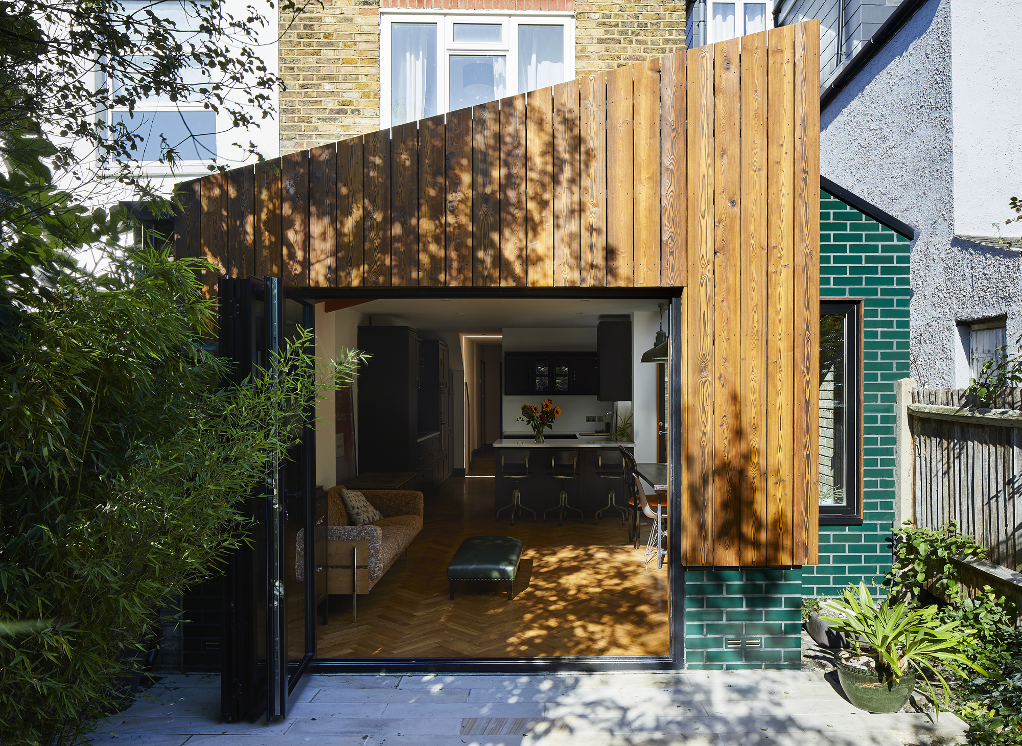 More living space wrapped in glazed brick and charred timber