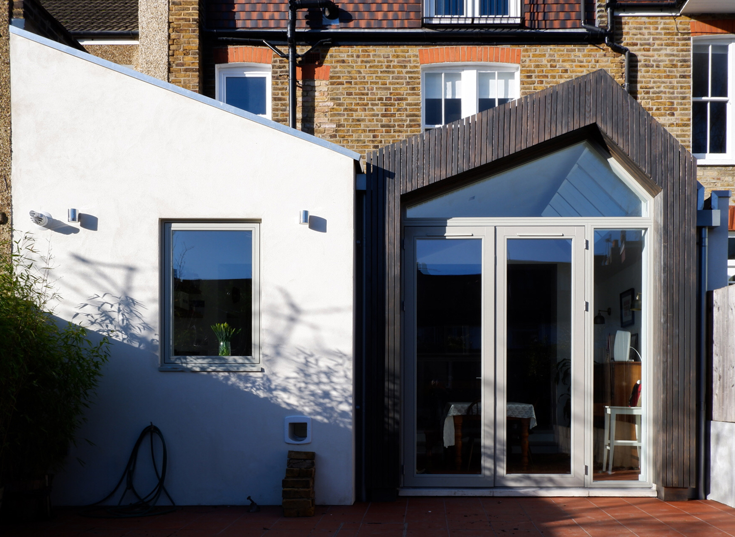Addition to an Edwardian family home with a distinctive roof profile